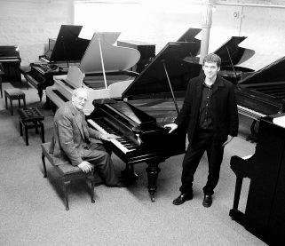 Mark Goodwin (standing) with Uncle Ronnie at piano