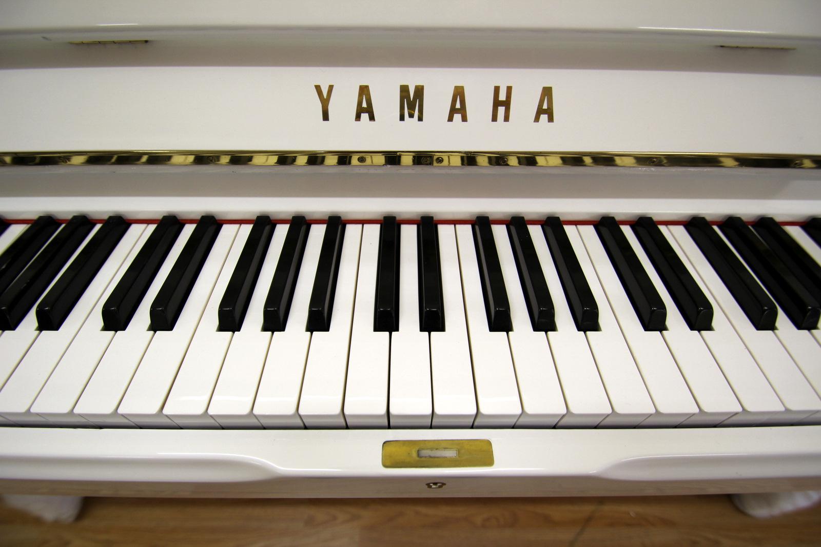 White Yamaha U1 Upright Piano